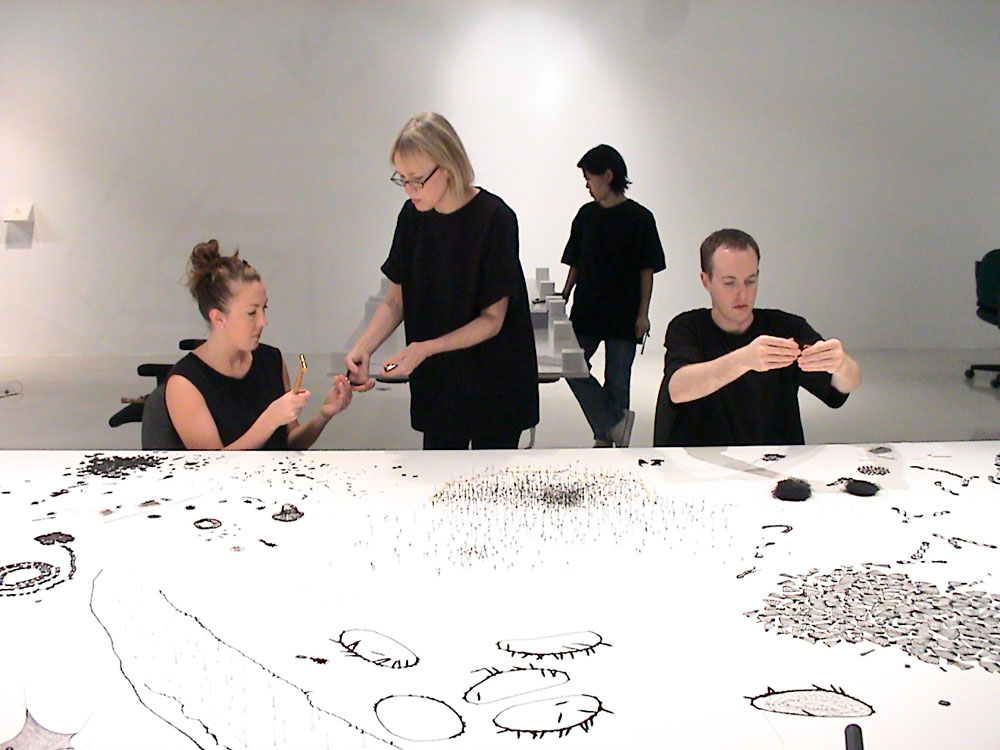 photo of Anne Wilson installing Topologies with assistants